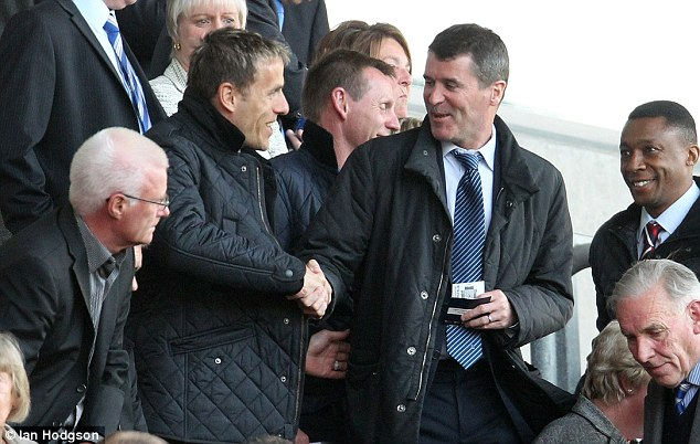 Reunited: Former United team-mates Phil Neville and Roy Keane were in the stands at the DW Stadium