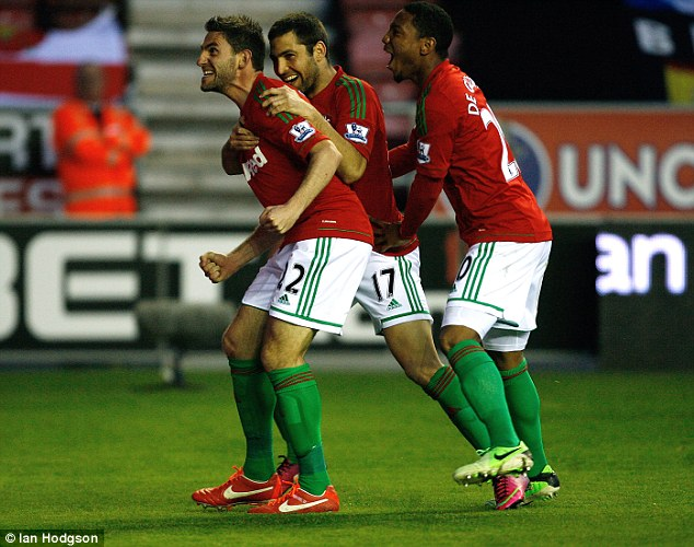 Level: Angel Rangel volleyed home at the beginning of the second half to equalise for Swansea