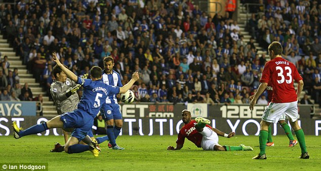 Winner: Dwight Tiendalli's goal in the 76th minute secured all three points for Swansea in a 3-2 victory at Wigan