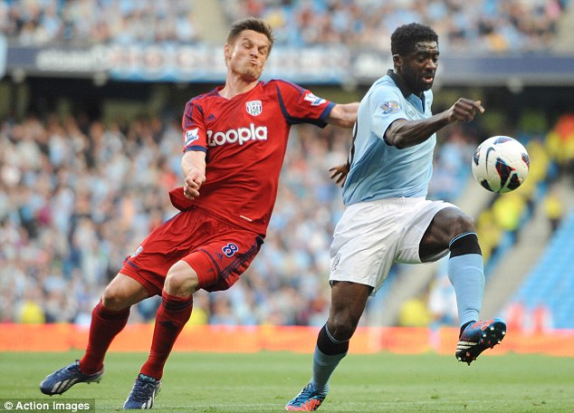 On his way: Kolo Toure (right) could join AC Milan at the end of the season