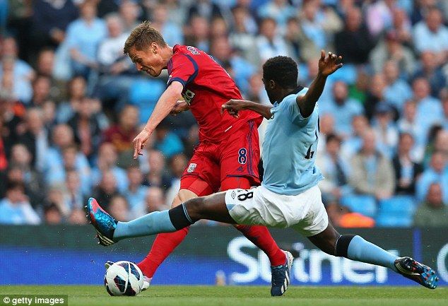 Outbound: Toure (right) is set to leave Manchester City this summer