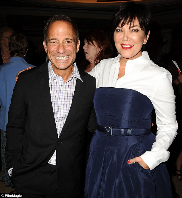 Frenemies? Harvey Levin's TMZ website and show are - how can we put this - rather impish about Kris and her family, but she posed with him happily