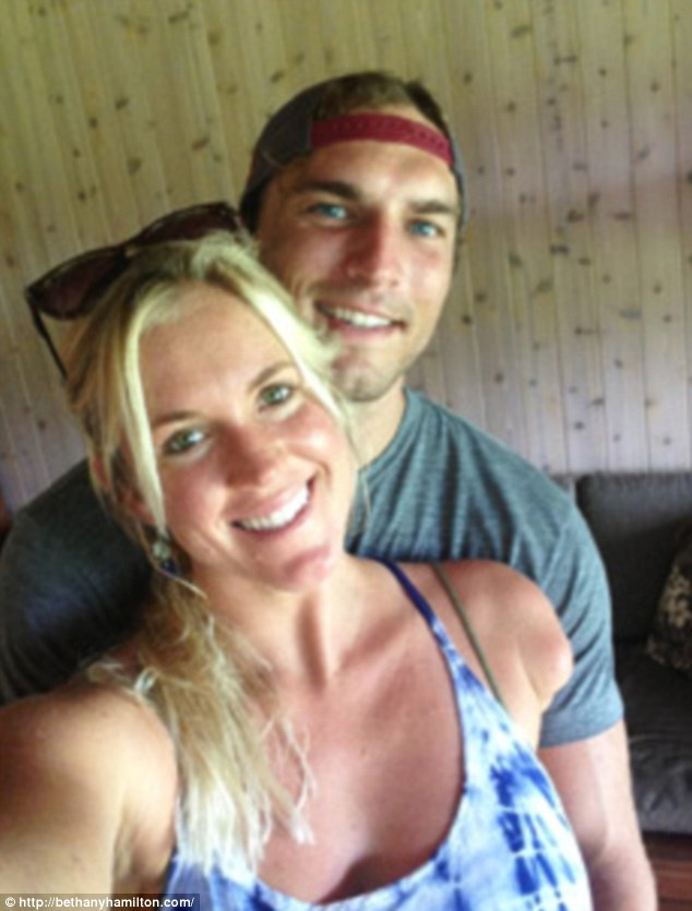 The look of love: The professional surfer met her fiancé, a Christian youth minister, on a blind date where the pair jumped off of a cliff together