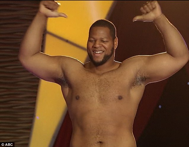 Muscle man: American football star Ndamukong Suh, 26, hurled a man dressed as a player into the pool