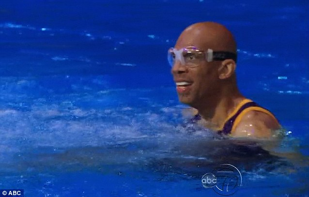 Giant leap: Retired basketball pro Kareem Abdul-Jabbar, 66, casually bounced a ball as he walked along the 16 ft high board