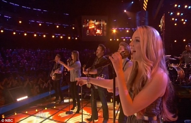Hands in the air: Team Blake brought the audience to its feet with their group performance