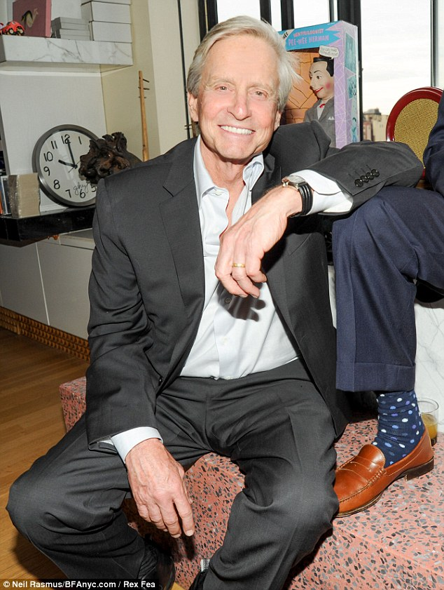 Brave face: Michael Douglas smiled for the cameras at the Limoland Collection launch in New York on Tuesday, while wife Catherine Zeta-Jones is still in rehab