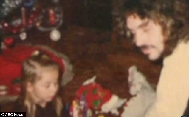 A young Amanda Berry plays with her presents on Christmas morning with her father Johnny