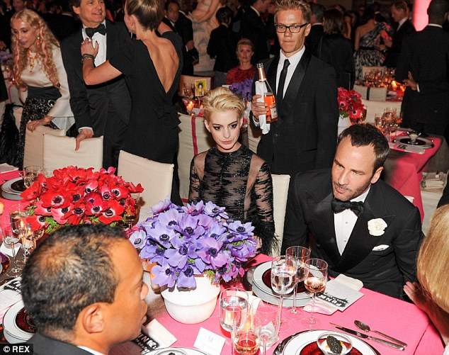 Hole in one: Tiger was on his best behaviour at the Met Gala as he chatted to designer Tom Ford and Anne Hathaway