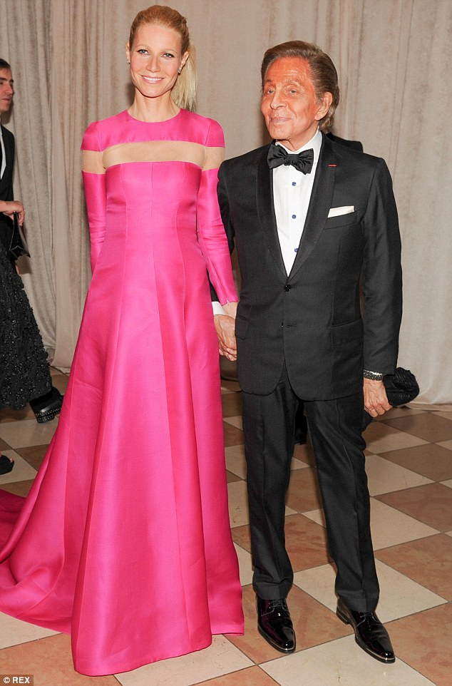 The perfect accessory: Designer Valentino looked smooth in his black tuxedo and Gwyneth Paltrow also looked beautiful in pink