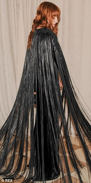 Taking off: Singer Florence Welch stood out in her long tasseled black dress