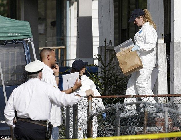 Probe: Members of the FBI evidence response team carry out evidence from the home on Tuesday