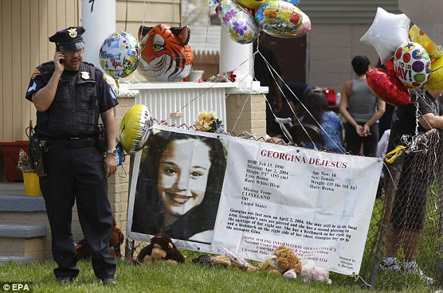 A policeman stands watch as well wishers gather at Gina DeJesus' home in Cleveland, Ohio, yesterday waiting for her homecoming