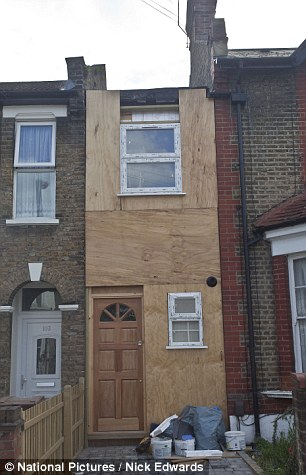 The plywood construction hides what used to be a dilapidated shed