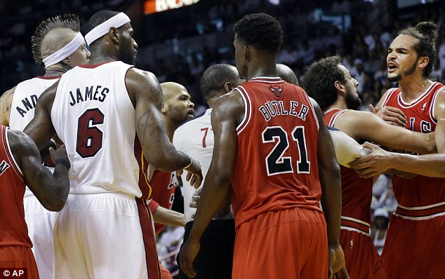 Tempers flare: Joakim Noah (right) remonstrates with James - Noah was later ejected from the game