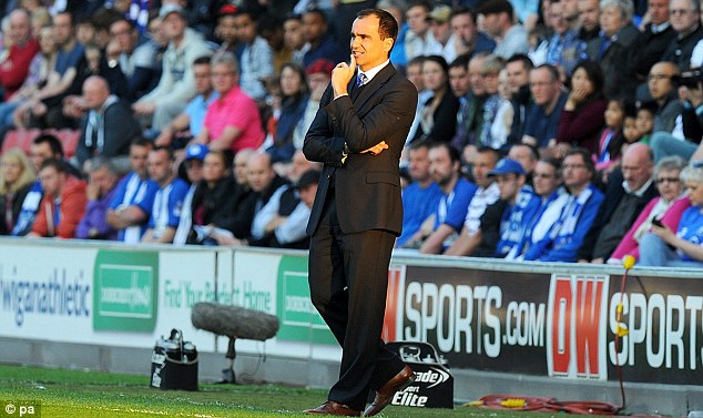 Outnumbered: Roberto Martinez's Wigan will not have as many fans as Manchester City at the FA Cup final
