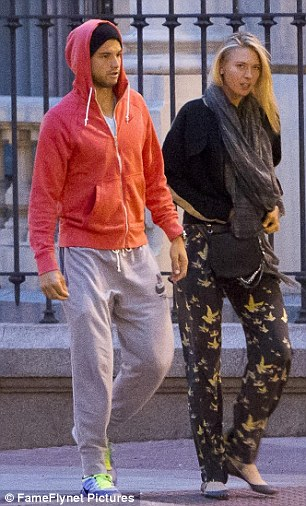 Walking and talking: The lovebirds strolled through Spain's capital city getting to know each other better