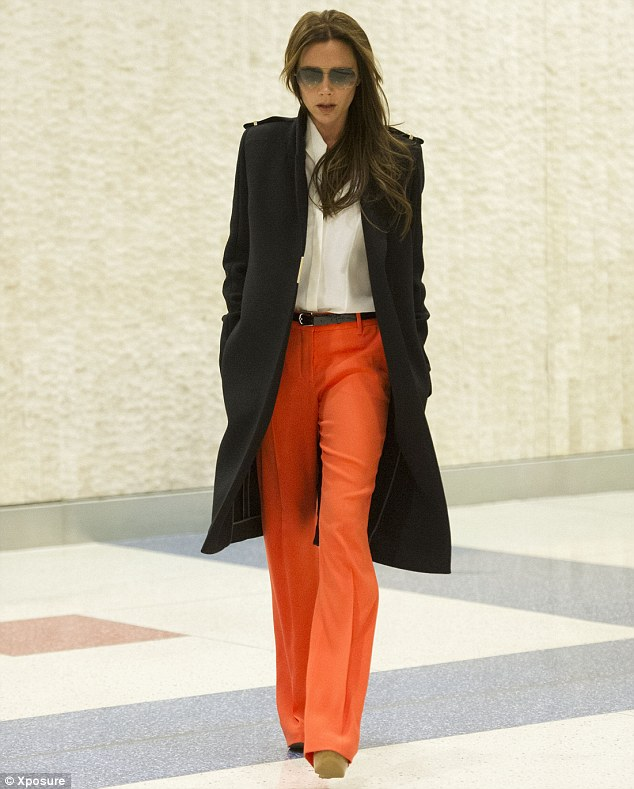 Day wear: The fashion designer looked picture perfect as she strutted through the terminal