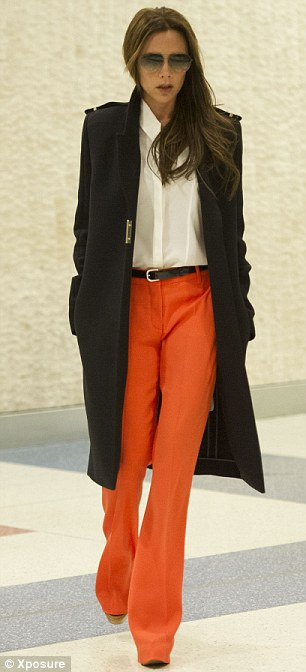 Shine on: Victoria certainly turned heads as her extremely bright trousers drew attention