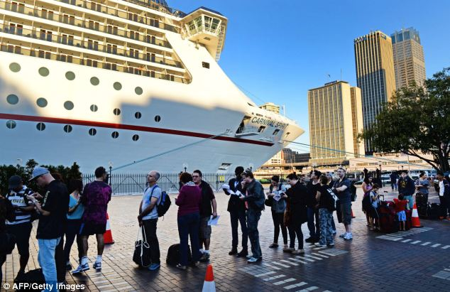 Voyage: Passengers queue at Sydney's Circular Quay to board the cuise ship Carnival Spirit for a Pacific cruise today
