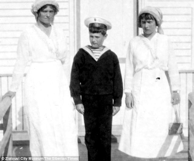 In this 1914 picture, four years before their execution, Nicholas's heir Alexei is seen with sisters Olga, left, and Tatiana, right