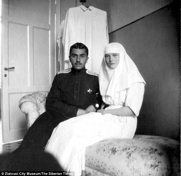 Grand Duchess Tatiana is seen with an unidentified soldier in another photo from the collection