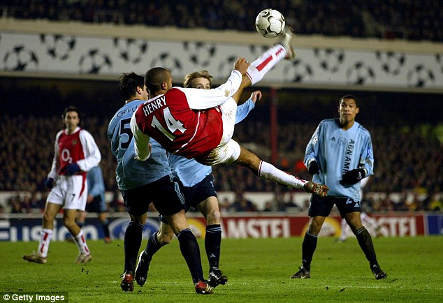 Spectacular: Henry attempts an overhead kick in Arsenal colours in a Champions League tie with Ajax in 2003
