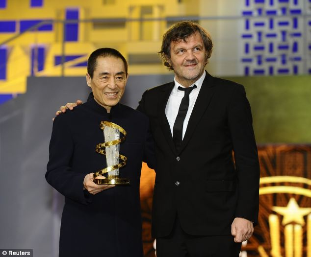 The celebrated filmmaker, pictured with Serbian film director Emir Kusturica at the 2012 Marrakech International Film Festival, could face a fine of 160million yuan (£17million)
