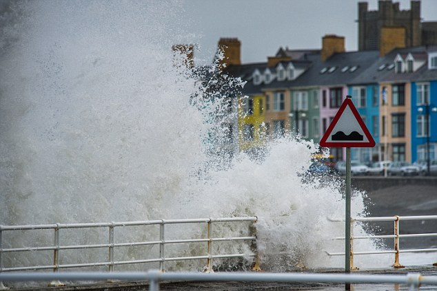 Concerns: The Met Office has issued a yellow weather warning for many parts of the country, while the Highways Agency has put an amber warning in place