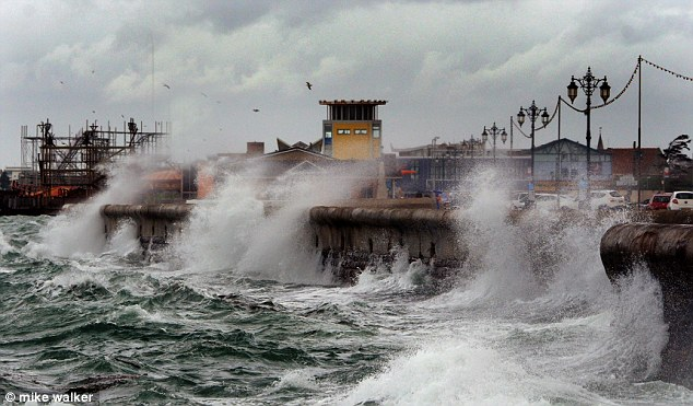 Dangerous: The strong winds are causing these enormous, choppy waves on the seafront at Southsea