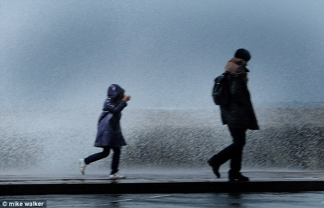 Blustery: The seafront at Southsea is proving to be hazardous for those walking along it today