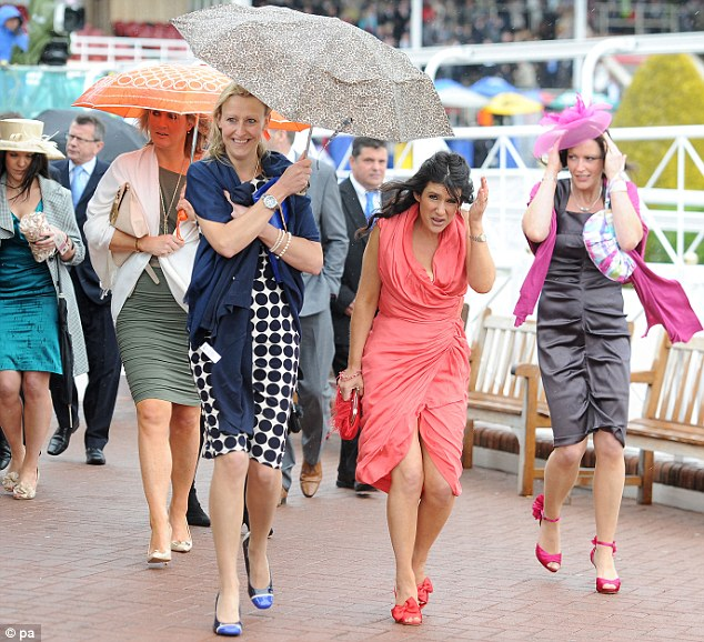Damp: Women attending Ladies Day at the Boodles May Festival at Chester Racecourse are in for a wet day