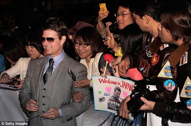 Fan favourite: Earlier in the week, Tom stopped in Tokyo to celebrate the Japanese release of Oblivion