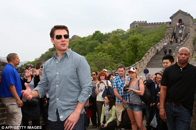 Drawing a crowd: The Mission: Impossible star was mobbed by admirers during his tour of the iconic landmark