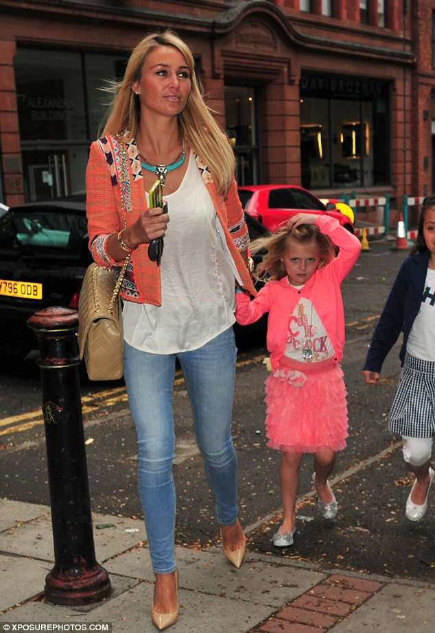 Girl time: Alex Gerrard took her two daughters to the concert and her children were dressed in adorable matching outfits