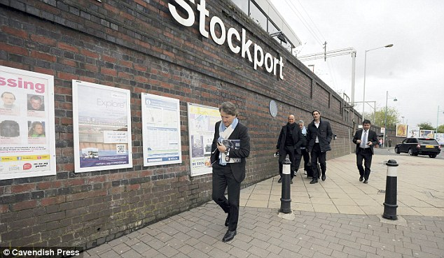 On his way: Manchester City boss Roberto Mancini arrives at Stockport Rail Station for the journey to Wembley and the FA Cup final