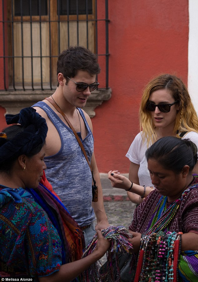 Sampling local wares: The pair were spotted checking out jewelery made by women on the island