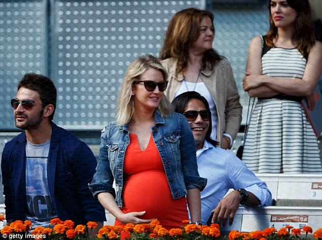 Fun in the sun: Falcao (right) sits besides his pregnant wife Lorelei Taron