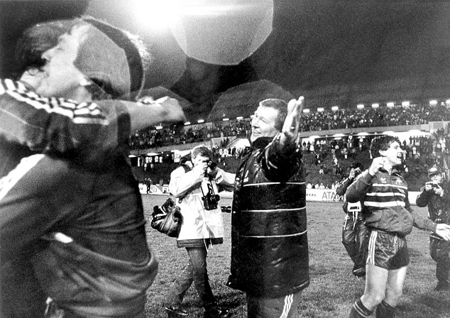 In the spotlight: A jubilant Fergie celebrates Aberdeen's win on the pitch at the Ullevi Stadium