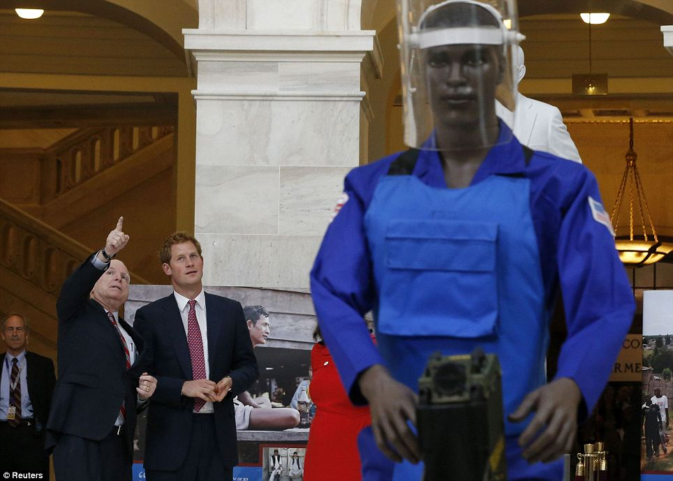 Moving on from business: Though they were at the Capitol building to tour the landmine detection equipment, even Senator McCain couldn't help pointing out the adoring masses