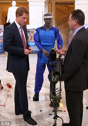 Trying his hand: The Prince took a closer look at one of the anti-landmine devices
