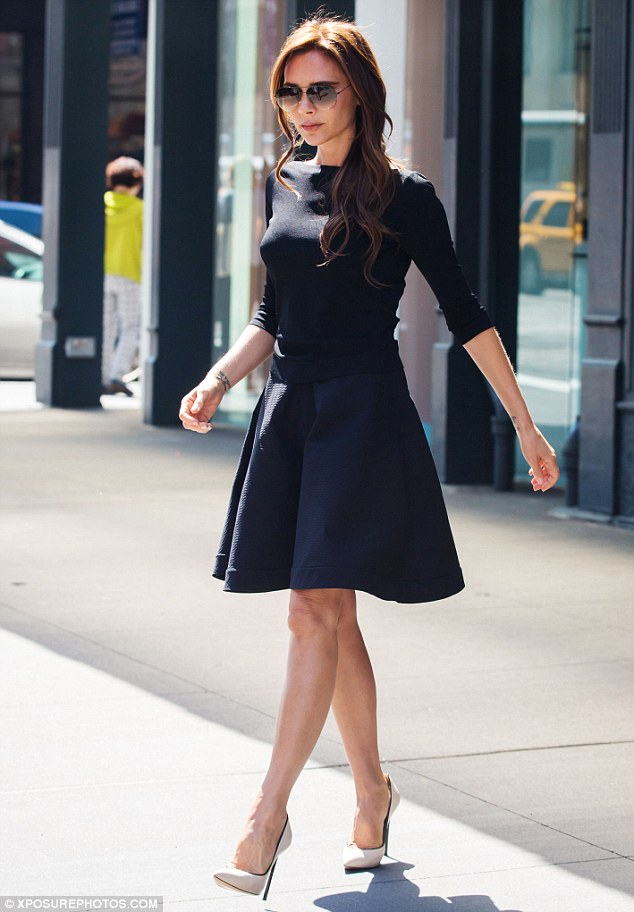 As immaculate as ever: Just a day earlier Victoria had tweeted her online fans about what a rainy day in New York it was, but the sun was certainly shining on Friday
