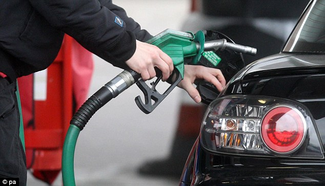 A man fills a car with petrol