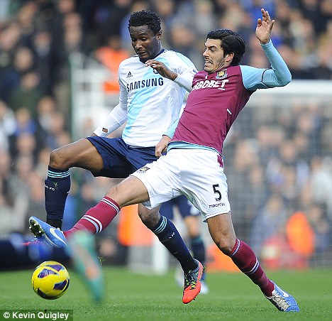Out of reach: James Tomkins (right) has missed West Ham's last four matches