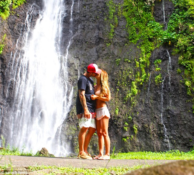 Water world: To cap off the romantic holiday pictures Bohan and Partridge embraced lovingly against the backdrop of a waterfall