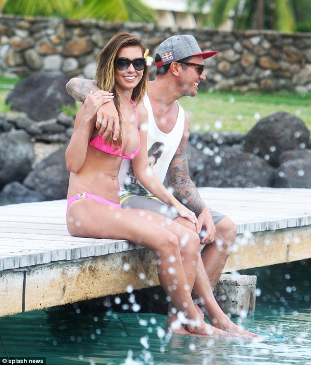 Making waves: Audrina and Corey kicked up a storm as they dangled their feet in the water