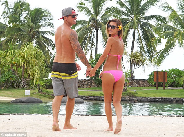 Mind the gap: Audrina and her BMX biker beau walked off into the distance not minding the water
