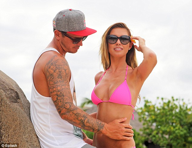 Say cheese: Audrina Partridge and Corey Bohan indulged in some less than natural looking photographs on holiday in Tahiti on Thursday