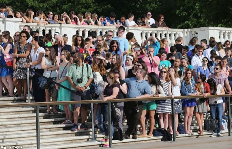 Fans: People flocked to Arlington Cemetery for a glimpse of the prince, who is in the U.S. for a week