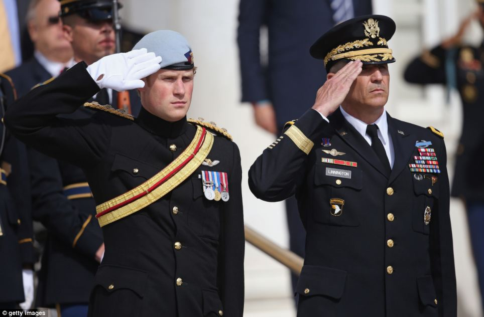 Official: Prince Harry pays his respects to the victims of the Afghanistan conflict and the tomb of the unknown soldier accompanied by Major General Michael Linnington
